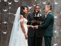 Bride and groom at altar during ceremony with officiant