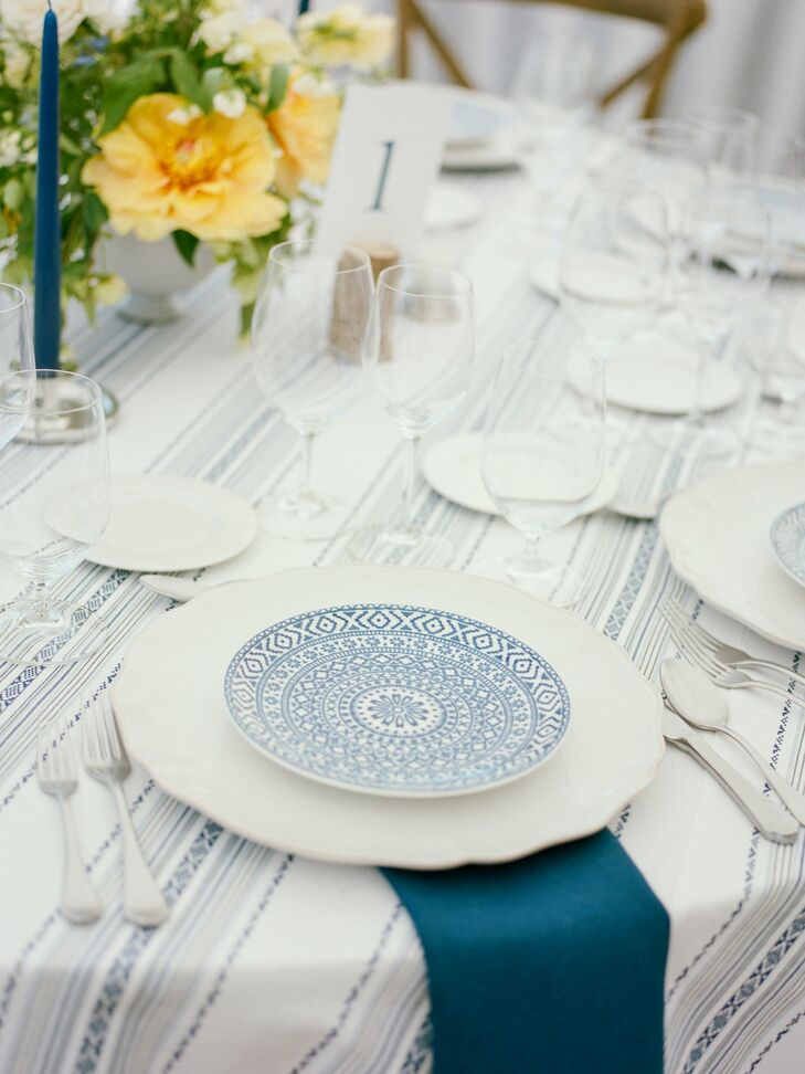 Blue Patterned Dinnerware and Striped Tablecloth