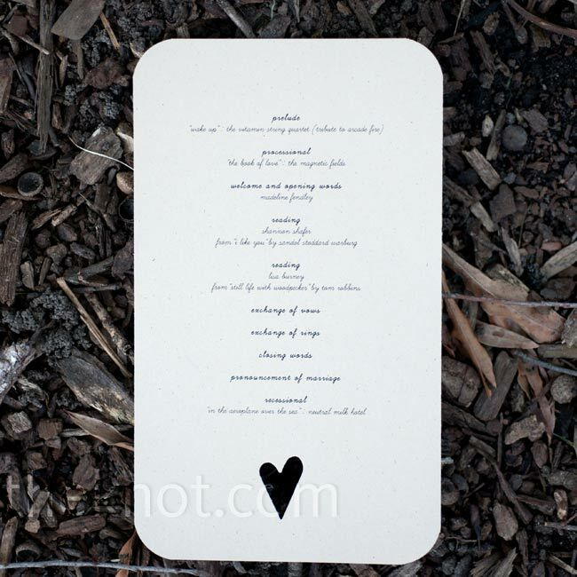 The wedding details were printed on natural kraft stock in black ink and had asymmetrical hearts cut out of the bottom of each card.