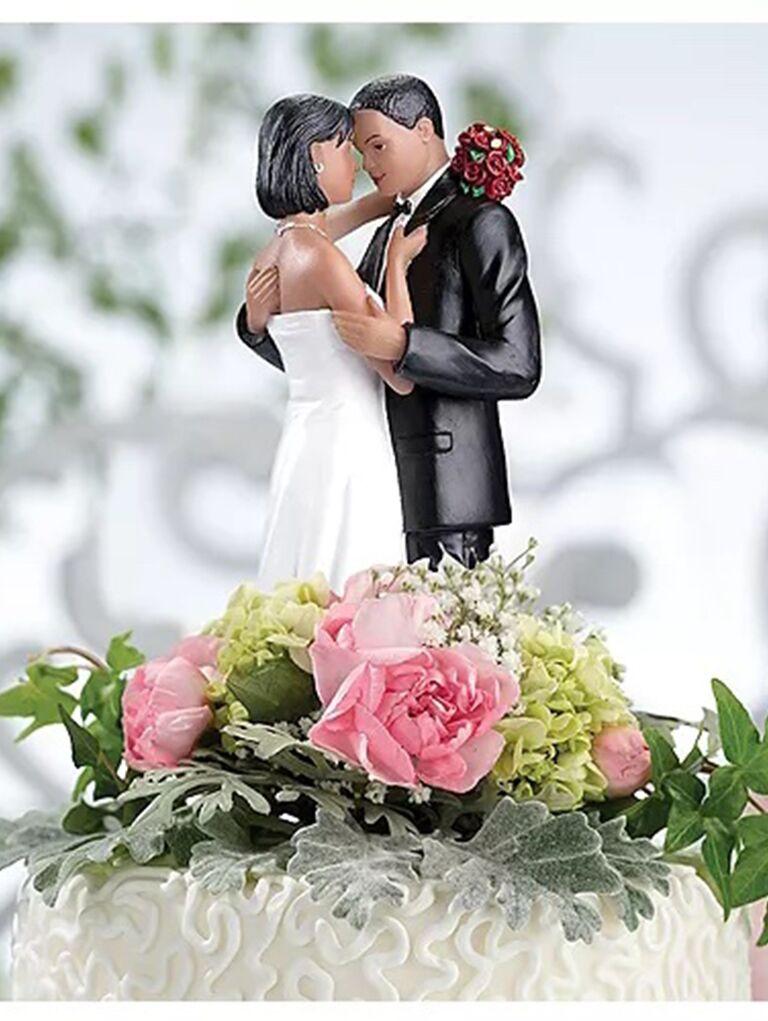 Resin topper of bride and groom dancing
