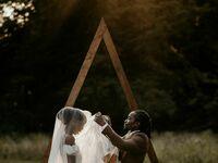 Groom lifting bride's veil during wedding ceremony