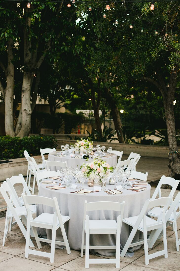 Guests sat in the Cafe Pinot garden at round white linen-topped tables decorated with rose gold flatware and flowers set in vintage porcelain vases.