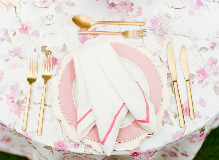Pink-and-gold place setting with patterned linens