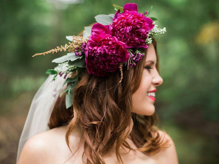Bride wears an oversized flower crown on her wedding day.
