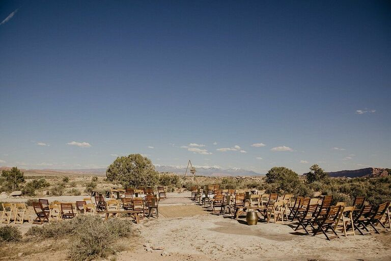 Wedding ceremony in the desert with wood folding chairs