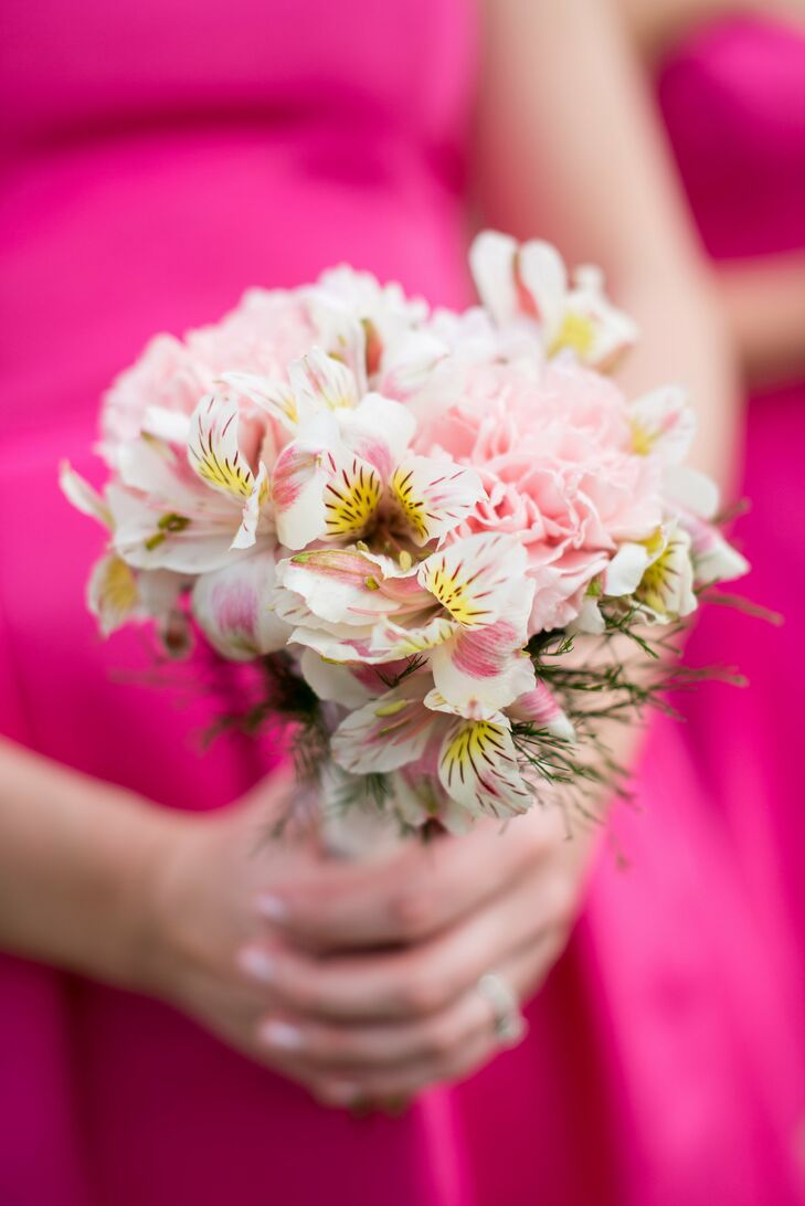 Shelby's bridesmaids carried pink bouquets of alstroemerias and carnations. The soft pink coloring of the bouquet contrasted with the hot pink bridesmaid dresses.