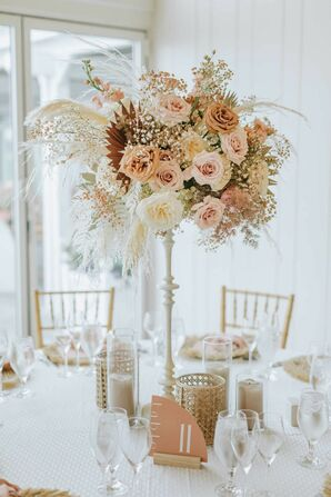 Tall Centerpiece With Pampas Grass, Baby's Breath and peach Roses