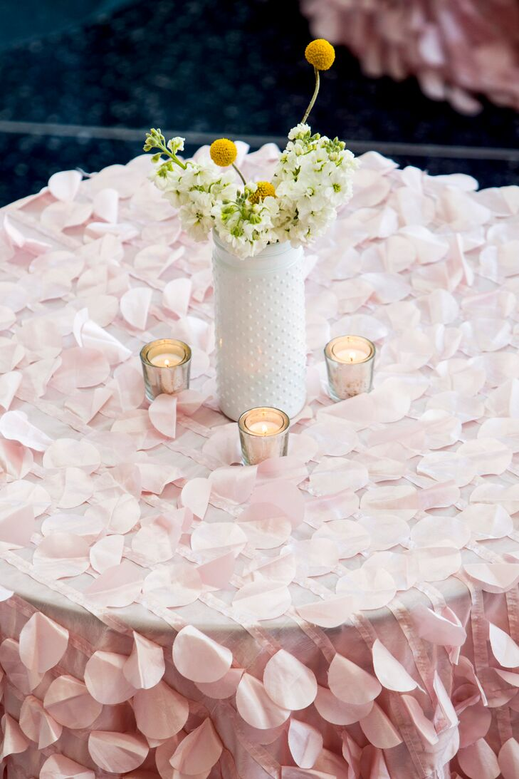 White Centerpiece on Pink Petal Tablecloth