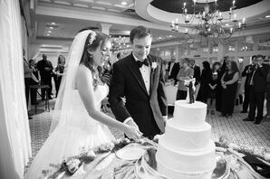 Couple Cutting Three-Tier White Wedding Cake