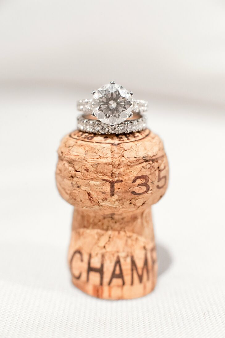 Mackenzie's custom made round-cut diamond wedding ring was placed on top of a champagne cork to expand on her French winery theme.