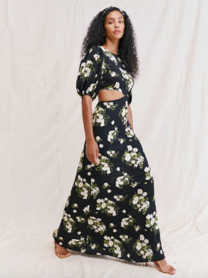 Black floor-length fall wedding guest dress with puff sleeves and side cutouts