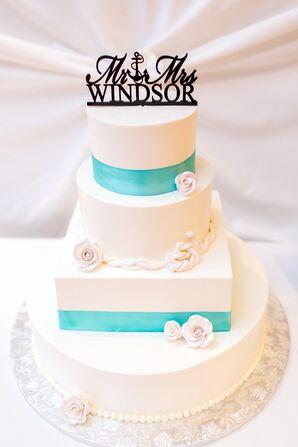 White Wedding Cake With Turquoise Ribbon