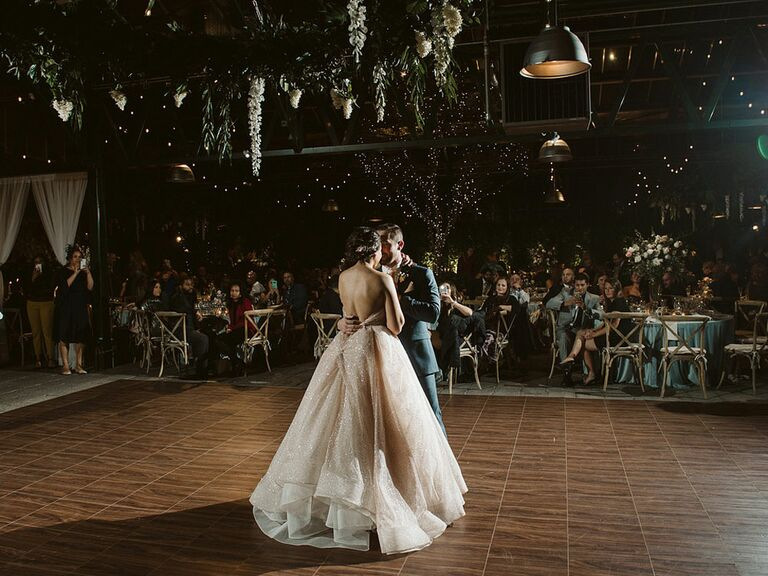 Bride and groom during first dance at wedding reception