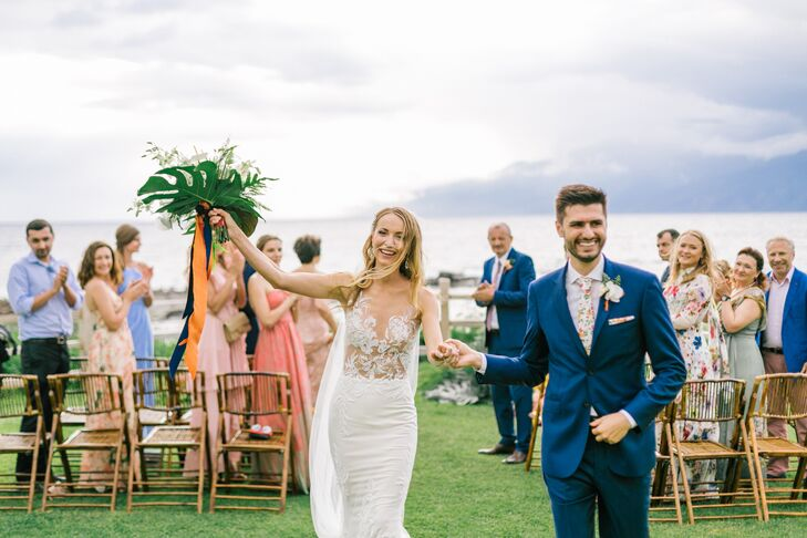 """""""The elegant, chic and romantic mermaid gown was designed by Ines Di Santo and was perfect for Hawaii,"""" says Evgeniya. In a nod to the verdant setting, the groom donned a bright blue suit with a floral-print tie."""