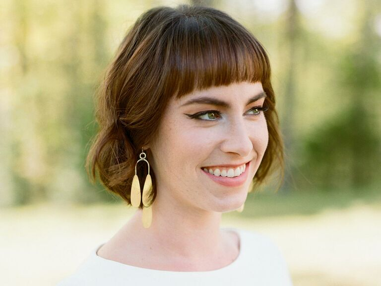Short hair pinned half-up with straight bangs