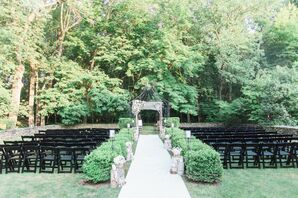 Outdoor Jewish Ceremony With Black Folding Chairs