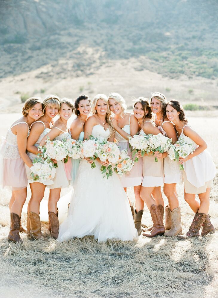 The bridesmaid dresses were custom designed by Armour Sans Anguish using vintage materials in soft shades of blush to create an eclectic and country look.