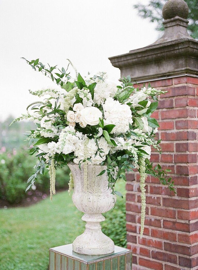 Romantic white floral arrangement in urn