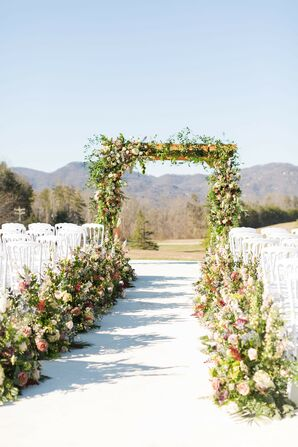 Outdoor Mountain Ceremony with Natural, Rustic Wedding Arch and Whimsical Floral Aisle Decorations