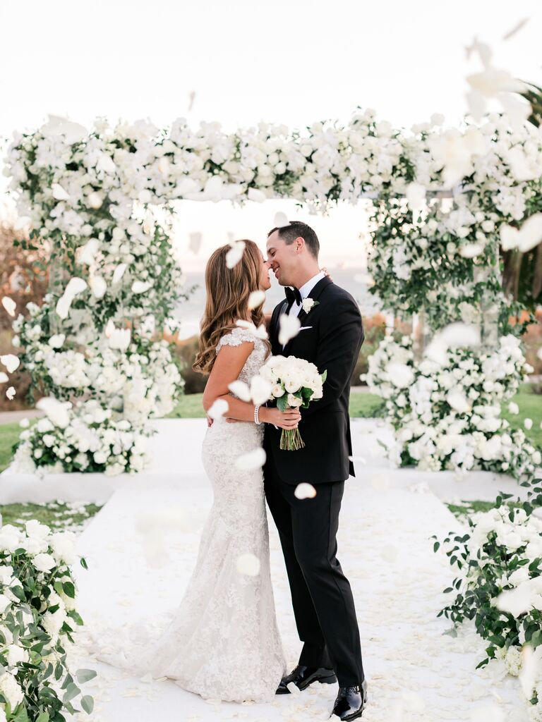 couple kissing with confetti