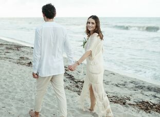 Diana and Rafael chose an intimate beach wedding in Palomino, Colombia, to celebrate their love story, which began with a movie-worthy first kiss in a
