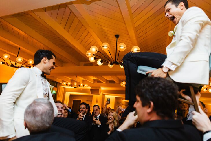 """At the indoor reception, Jay and Wes were lifted for the hora. """"Get started early, and do things your way,"""" Jay and Wes say. """"Don't let others' opinions sway you."""""""