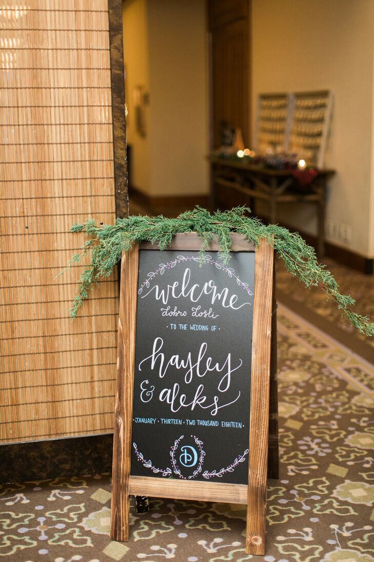 Rustic Wood Sign with Calligraphy and Pine Leaves