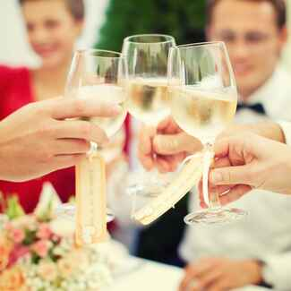 Guests toast with wine at a wedding