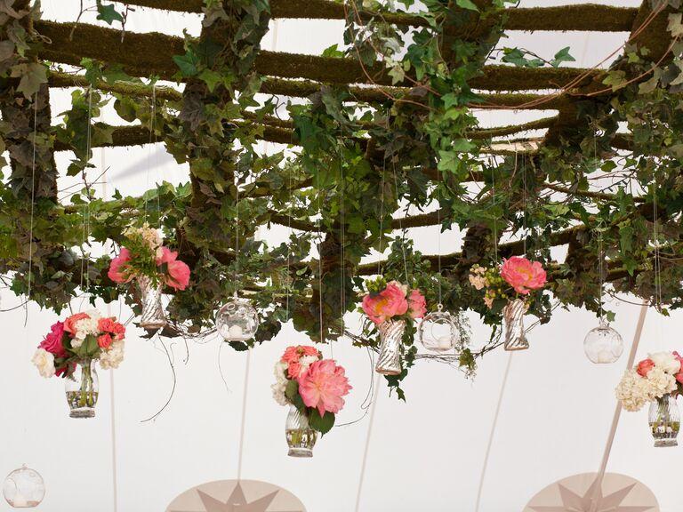 Suspended trellis decor with ivy and hanging bud vases