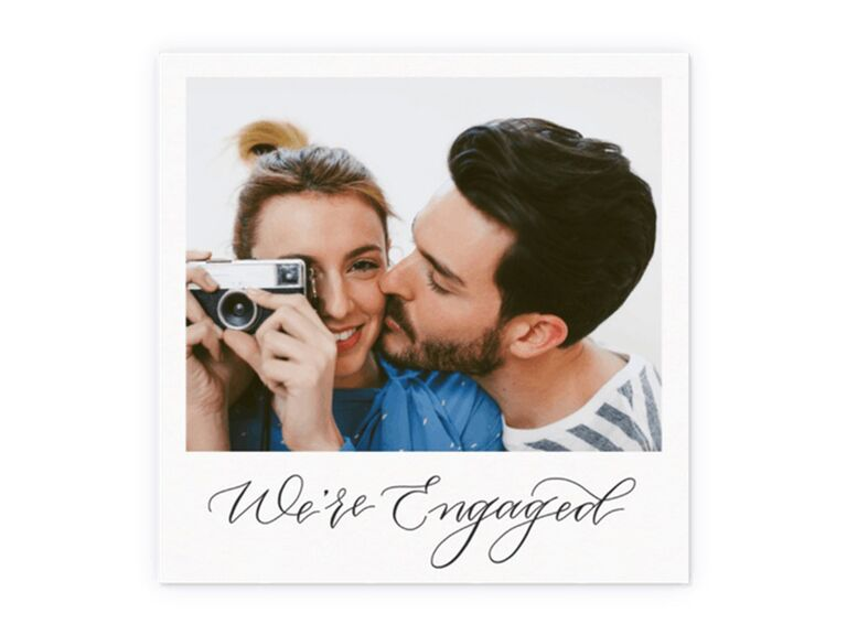 Polaroid design with personalized photo and 'We're engaged' in calligraphy