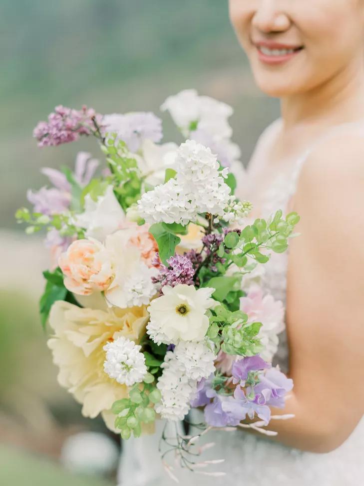 bride holding lilac bouquet