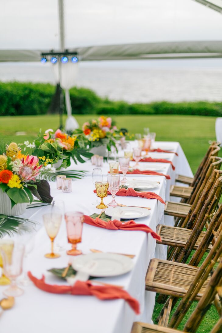 """""""Our dinner consisted of one u-shaped table so that everyone could interact with each other, family style,"""" says Evgeniya. """"Each place setting had a hand torn linen ribbon with guests names painted on them."""""""