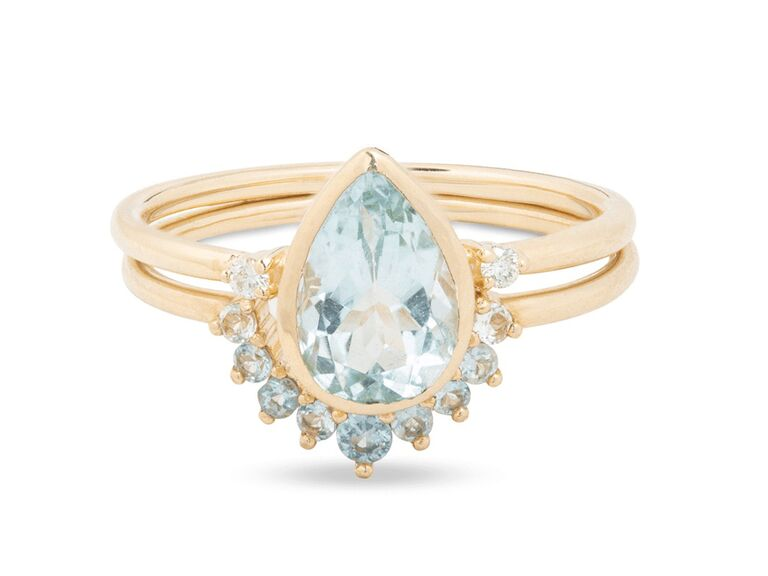 stone and strand pear cut aquamarine engagement ring with blue gemstones and gold tiara band