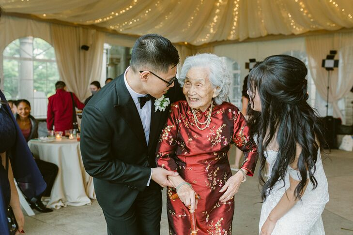 Newlyweds Talking With Grandmother During Reception