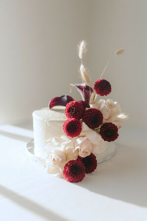 Small Cake with Burgundy Dahlias Blooms at Metropolist in Seattle, Washington