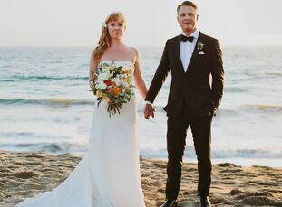 Gwynne Crowley (35 and a freelance producer) and David Lowrie-Reed (40 and in marketing) exchanged vows under a dream catcher wedding arch on the sand