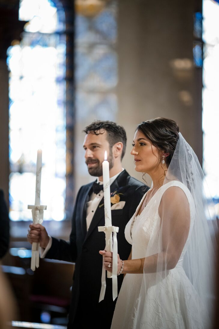 Couple Holding Candles During Traditional Greek Orthodox Wedding Ceremony