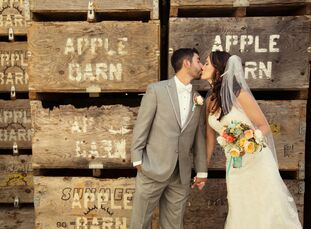 Lindsay Baldwin (23 and a yoga instructor) and Niles Dhanens (27 and a mechanical engineer) chose a rustic theme inspired by their reception at an old