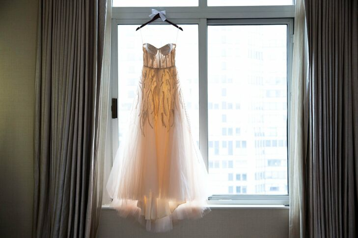 Jessica opted for a blush, tulle gown with wavy embroidered details on the skirt and a sweetheart neckline.