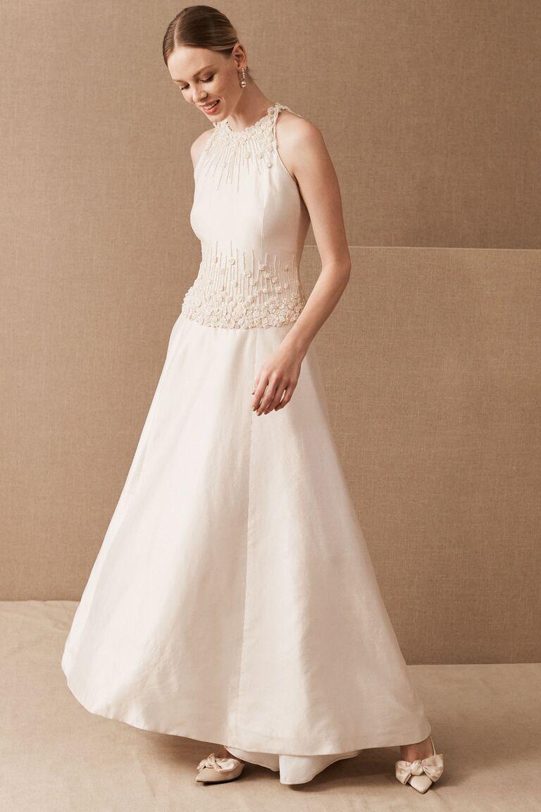 Silk A-line wedding dress with beading along neckline and bodice