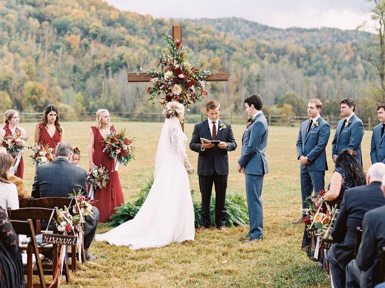 rustic wood ceremony cross for outdoor wedding