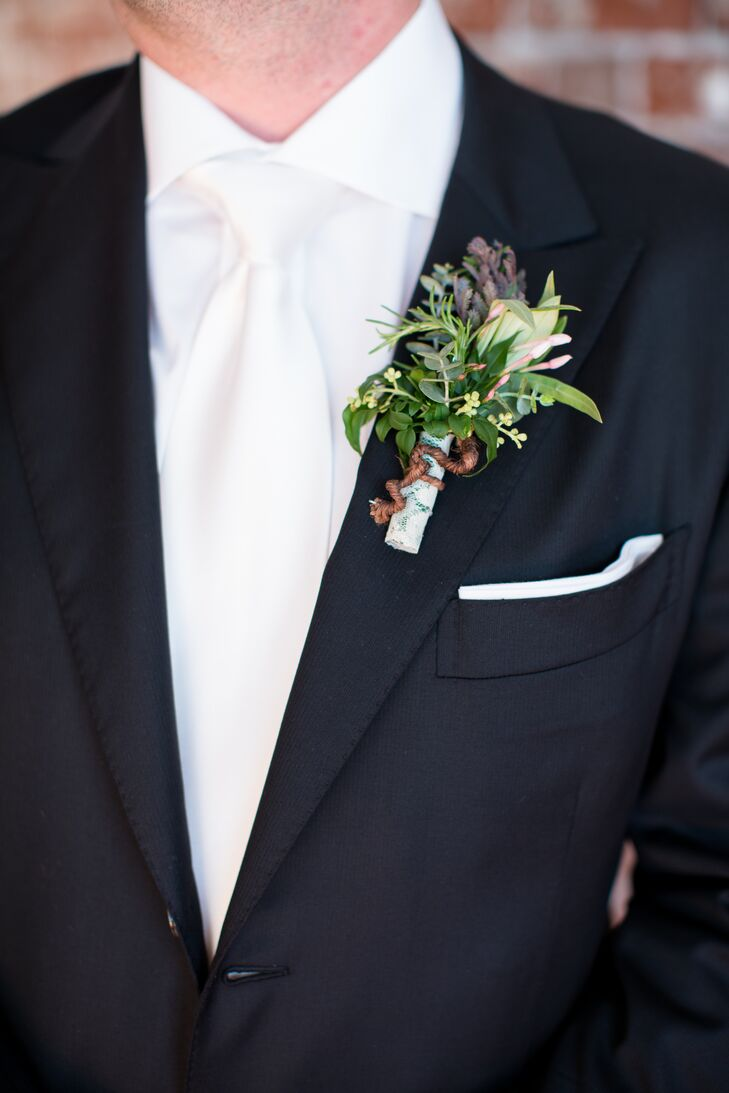 Walter wore a classic black tux with a white tie and a generous boutonniere made with succulents and sprigs of greenery.