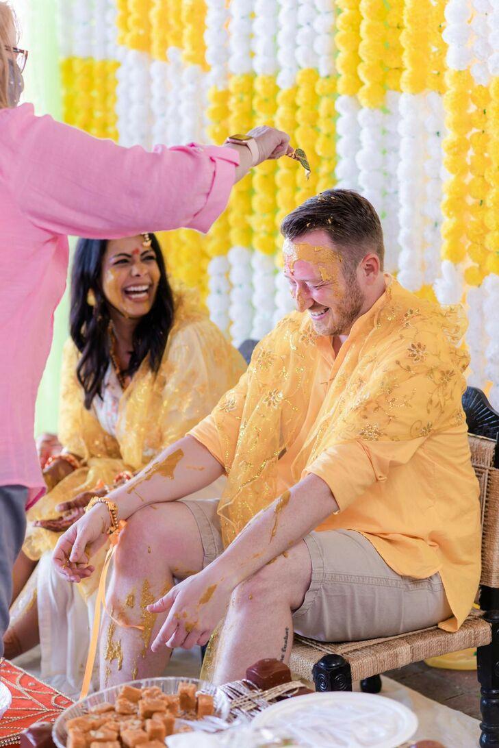 Bride and Groom at Pre-Wedding Haldi Ceremony With Turmetic