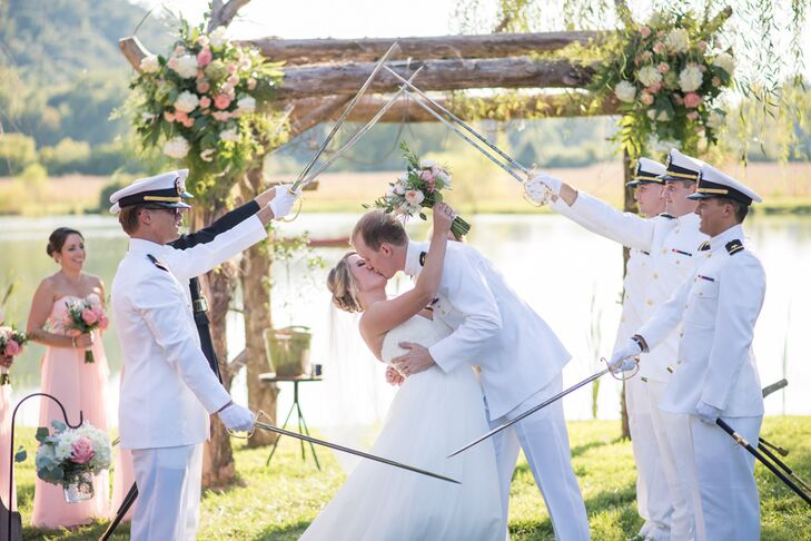 """After their marriage pronouncement and during their first kiss, Park's fellow Navy officers gave the newlyweds a sword salute. """"We had six military officers perform the arch, and it was definitely one of our favorite moments from the ceremony,"""" Morgan says. The couple walked down the aisle to Vitamin String Quartet's version of """"Concerning Hobbits,"""" a nod to their love for """"The Lord of the Rings."""""""