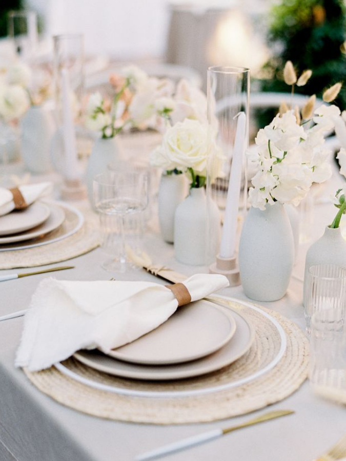 White-and-gray tables cape with bud vase arrangements