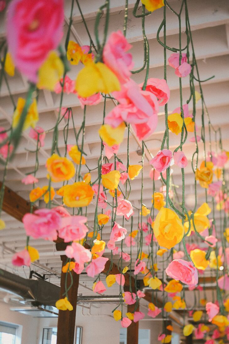 Pink and yellow paper flowers added a charming, retro vibe to the ceremony decor.