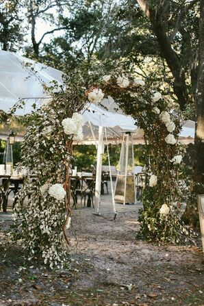 Wedding Guests Passed an Arch Made of Eucalyptus and Hydrangeas