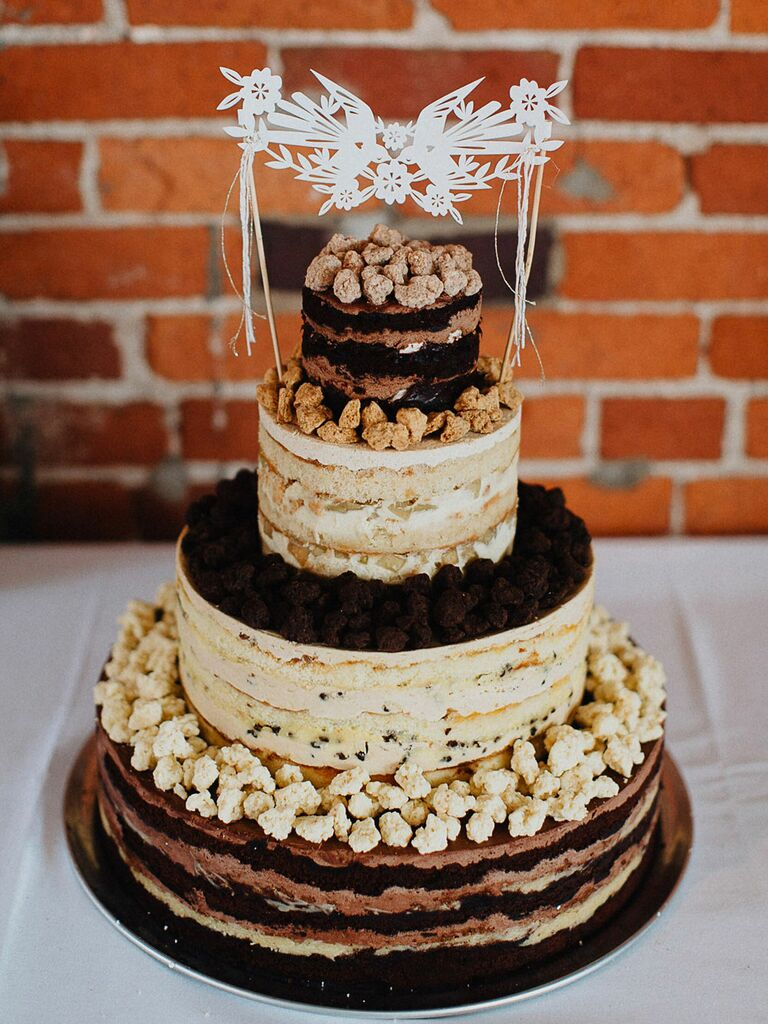 Four-tier naked rustic cake with exposed layers