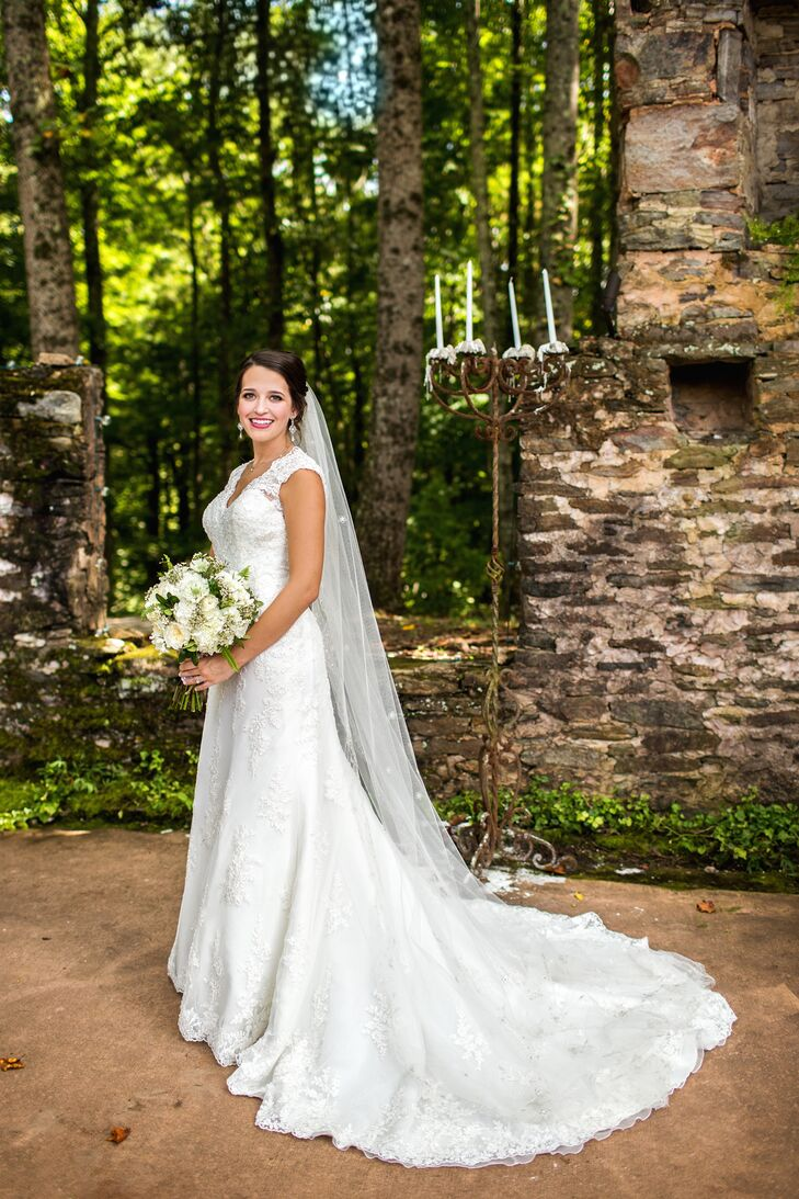 """It didn't take long for Sarah Beth to find the perfect dress. """"It was the second dress I tried on and was exactly what I wanted,"""" says Sarah Beth. """"It was lace with a keyhole back."""""""