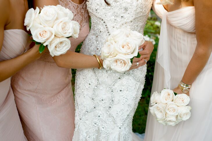Lindsay and Robert went classic on the flower front to let the beauty of the Tuscan scenery shine through. Lindsay's bridesmaids carried simple bouquets of pale blush roses, which went perfectly with their formal pink gowns.